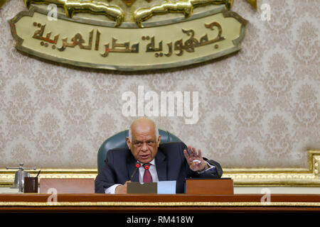 Cairo, Egypt. 13th Feb, 2019. Egypt's Parliament Speaker Ali Abdel Aal presides a plenary session to deliberate the proposed constitutional amendments that will increase the country's President term in office from four to six years. The Parliament members will vote later on the amendments before referring it to the Legislative and Constitutional Affairs Committee to be discussed in detail and to be finalized before being referred to the president to be put up for a public vote in a national referendum. Credit: Lobna Tarek/dpa/Alamy Live News - Stock Photo