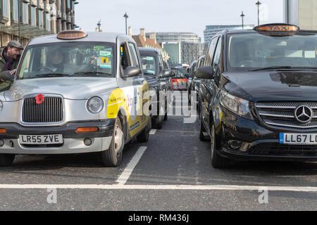London, UK. 13th February 2019, London, UK. taxi protest closes roads around Parliament Credit Ian Davidson/Alamy Live News - Stock Photo
