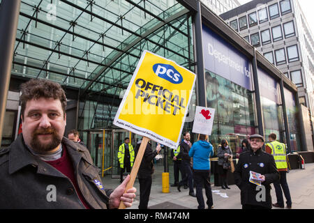 London, UK. 13th February, 2019. Outsourced workers belonging to the Public & Commercial Services union (PCS) walk out from the Department of Business, Energy and Industrial Strategy (BEIS) for their second day of strike action to demand the London Living Wage and an end to outsourcing. Union members handed out strike-themed cakes to supporters in return for donations to the strike fund. Credit: Mark Kerrison/Alamy Live News - Stock Photo