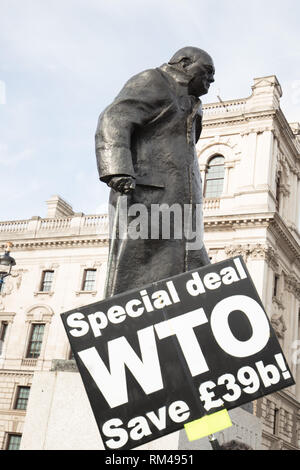 London, UK. 13th February 2019. Board in support of the Brexit WTO on Parliament Square, London UK, today. Credit: Joe Kuis /Alamy Live News - Stock Photo