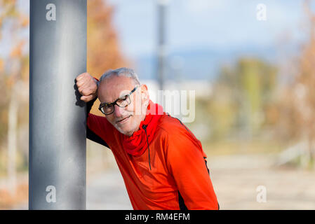 Handsome middle aged man in sports uniform looking at camera and smiling - Stock Photo