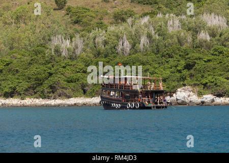 Excursion boat anchored in front of bathing island Hon Mot, Bay of Nha Trang, South China Sea, Nha Trang, Vietna - Stock Photo
