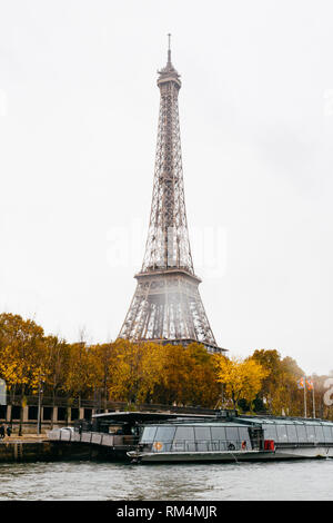 PARIS, FRANCE - NOVEMBER 11, 2018 - Tour Eiffel in a rainy day during the Seine's navigation in bateau mouche - Stock Photo