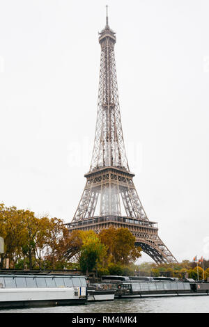 PARIS, FRANCE - NOVEMBER 11, 2018 - Tour Eiffel during the Seine's navigation in the bateau mouche in a rainy day - Stock Photo