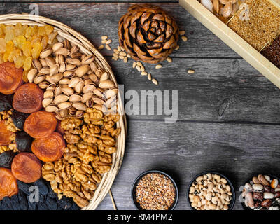 Health food for fitness concept with dried fruit, nuts, cereals, grains. High in antioxidants, fibre, smart carbs, minerals and vitamins E, K - Stock Photo