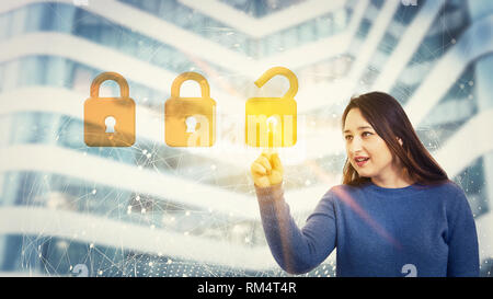 Woman touch a digital screen interface with choosing the right padlock from other options. Unlocking fingerprint scanning, future security password cy - Stock Photo