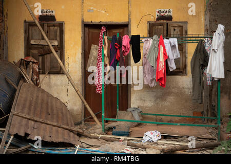 Cambodia, Kampot Province, Kampot city, Old Market area, investment opportunity, washing outside decaying old French colonial buildings - Stock Photo
