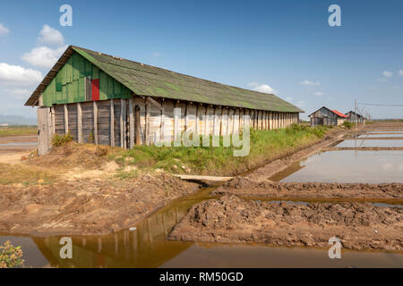 Cambodia, Kampot Province, Kampot, Tuek Chhou, Salt Fields, wooden buildings used to store salt - Stock Photo