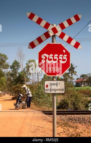 Cambodia, Kampot Province, Kampot, Tuek Chhou village, stop sign at level crossing on Phnom Penh to Sihanoukhville railway line - Stock Photo