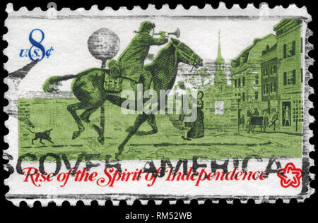 USA - CIRCA 1973: A Stamp printed in USA shows the Postrider, from the series 'Rise of the Spirit of Independence', circa 1973 - Stock Photo