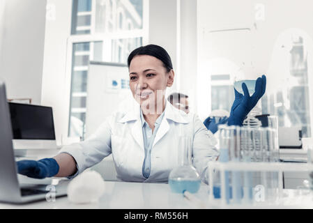 Scientist analysing the research results on the computer - Stock Photo