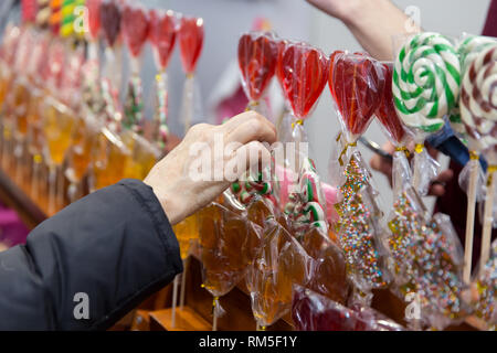 Group of packed colorful round lollipops on fair. - Stock Photo