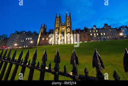 Night view of Edinburgh University New College building on The Mound in Edinburgh Old Town, Scotland, UK - Stock Photo