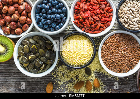 Healthy food, top view. Bowls with fresh ingredients for breakfast on table. Vegan diet concept. - Stock Photo