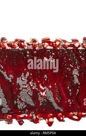 detail of bloody chainsaw isolated on white background - Stock Photo