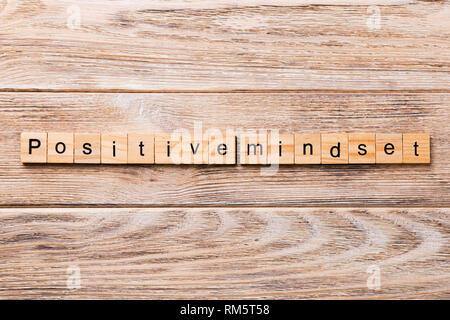 positive mindset word written on wood block. positive mindset text on wooden table for your desing, concept. - Stock Photo