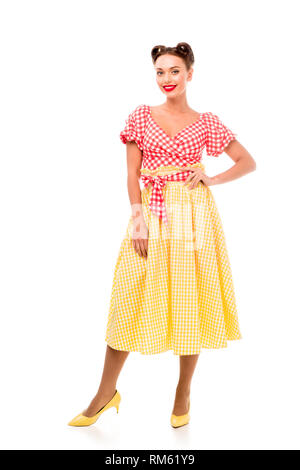 Beautifil pin up girl in vintage clothes posing on high heels and looking at camera isolated on white - Stock Photo