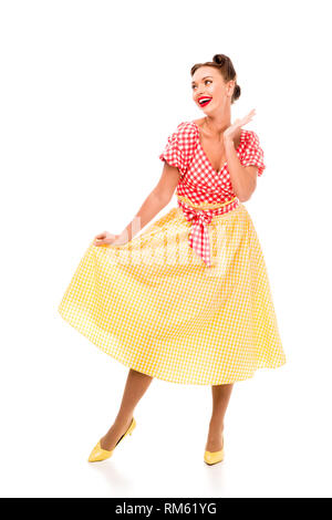 Beautiful pin up girl in bright vintage clothes posing on high heels isolated on white - Stock Photo