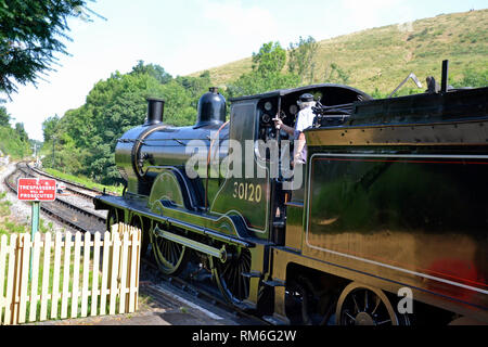 Driver on a steam train, on the Swanage Railway, Swanage, Isle of Purbeck, Dorset, UK - Stock Photo
