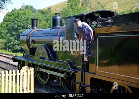 Driver on a steam train on the Swanage Railway, Swanage, Isle of Purbeck, Dorset, UK - Stock Photo