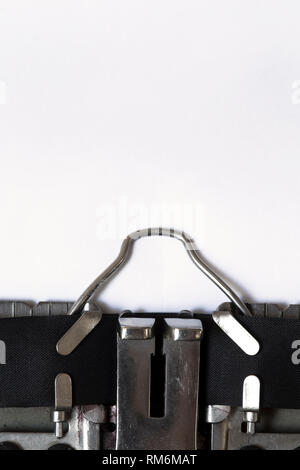 Typewriter with a white sheet of paper close up - Stock Photo