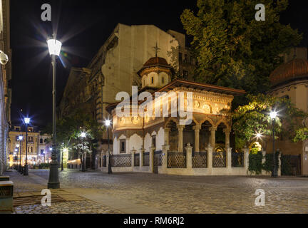Bucharest old city centre panorama view. Stavropoleos Church by night. Old town tourist attraction in Romania Bucharest - Stock Photo