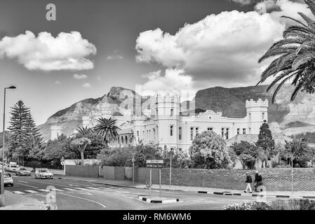 CAPE TOWN, SOUTH AFRICA, AUGUST 17, 2018: The historic Somerset Hospital in Green Point in Cape Town. People and vehicles are visible. Monochrome - Stock Photo