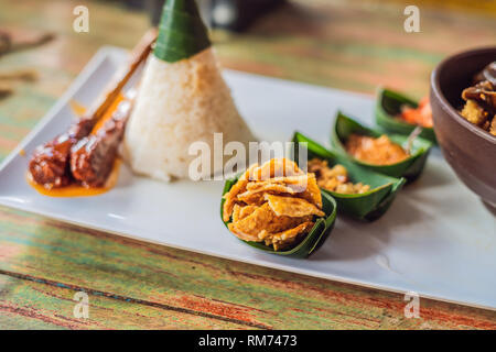 Lifestyle food. A dish consisting of rice, fried fish with wood mushrooms and different kinds of sauces - Stock Photo