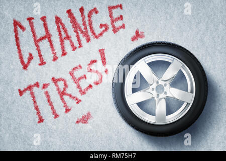 3d rendering of vehicle tire with red sign 'CHANGE TIRES' on grey background - Stock Photo