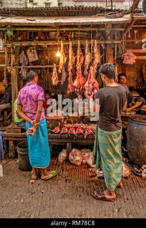 Markets and shops selling food, fish, and meat in Dhaka, Bangladesh. - Stock Photo