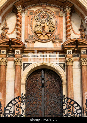 Grand ornate Baroque style West doorway and gate, exterior of Cathedral Basilica, Malaga, Andalusia, Spain - Stock Photo