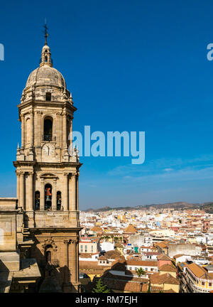 Bell tower and view over rooftops, Cathedral Basilica, Malaga, Andalusia, Spain - Stock Photo