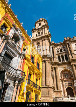 Episcopal Palace, Plaza del Obispo and view of  Malaga Cathedral bell and clock tower, Andalusia, Spain - Stock Photo