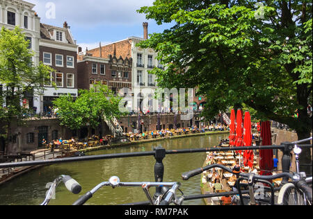 Amazing view on a lot of outdoor cafes alongside the Oudegracht (Old Canal) in the center of Utrecht, Netherlands - Stock Photo