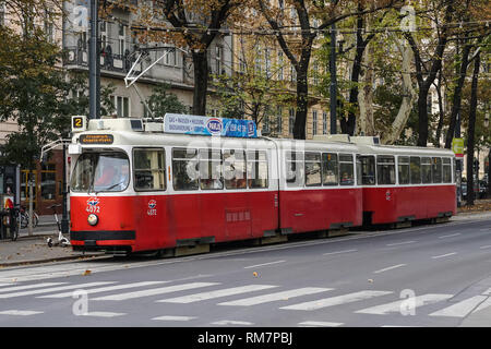 Typical red vintage tram on the Ringstrasse in Vienna, Austria - Stock Photo