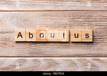 About us word written on wood block. About us text on wooden table for your desing, concept. - Stock Photo