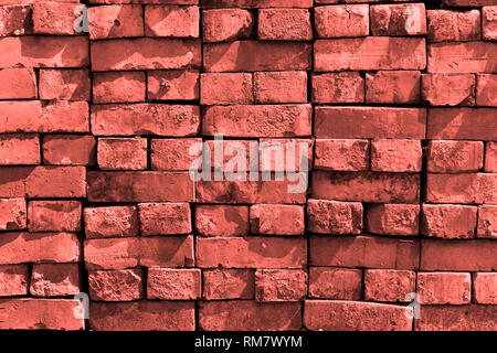 Brick wall in trend color 2019 Living coral