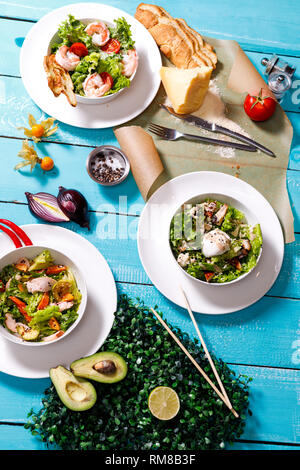 salad on a wooden blue table. - Stock Photo