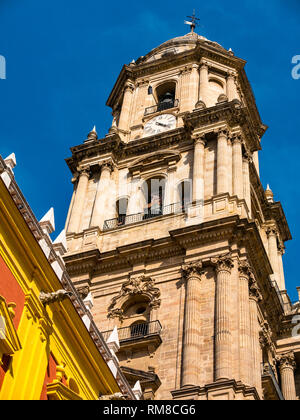 Episcopal Palace, Plaza Obispo and view of  Malaga Cathedral bell and clock tower, Andalusia, Spain - Stock Photo