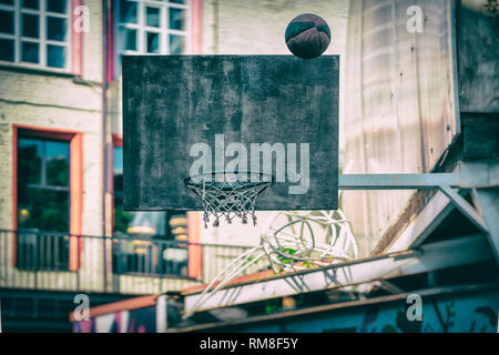 Street basketball game. Basketball shield, ball flies to the basket. Accurate throw in basketball ring. Concept of sport, hit accuracy, active - Stock Photo