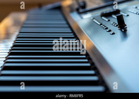 Midi keyboard synthesizer piano keys closeup for electronic music production - Stock Photo