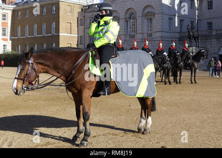 Sleeping police horse guarding the blues and Royals on Horse guards parade ground - Stock Photo