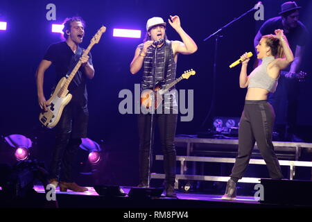 The Band Perry are shown performing on stage during a 'live' concert appearance. - Stock Photo