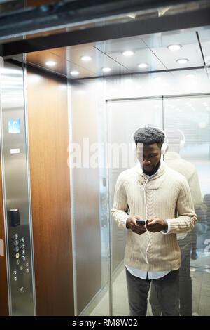 Guy in elevator Stock Photo
