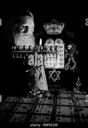 A Chicago rabbi lights Hanukkah candles, ca. 1944. - Stock Photo