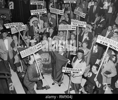 A group of delegates from Idaho at Chicago's Blackstone Hotel dress up as Native Americans and put on a demonstration promoting New York Gov. Averell Harriman for the 1956 Democratic presidential nomination in Chicago. - Stock Photo