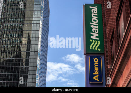 MONTREAL, CANADA - NOVEMBER 7, 2018: Logo of National Car Rental and Alamo on their main office for Montreal, Quebec. National and Alamo are car renta - Stock Photo