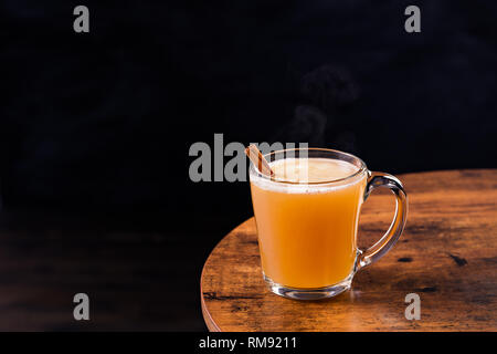 Warm Whiskey Hot Buttered Rum on a Table - Stock Photo