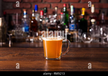 Warm Whiskey Hot Buttered Rum on a Bar - Stock Photo