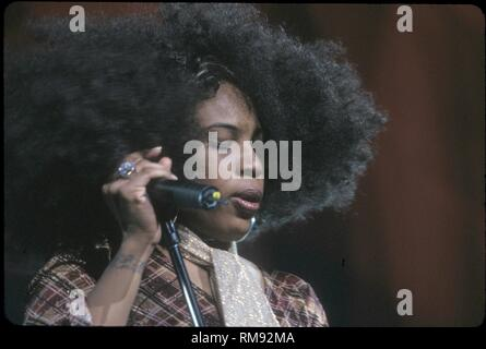 R&B, soul, and neo soul singer-songwriter, record producer, and actress Macy Gray famed for her distinctive raspy voice and a singing style heavily influenced by Billie Holiday and Betty Davis, is shown on stage during s concert performance. - Stock Photo